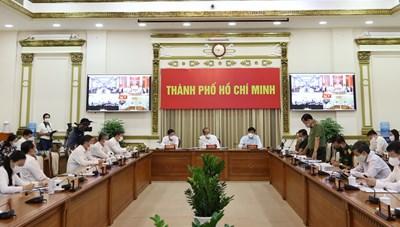 Hình ảnh buổi làm việc giữa Phó Thủ tướng Thường trực Chính phủ Trương Hòa Bình và lãnh đạo TPHCM về công tác phòng, chống dịch Covid-19