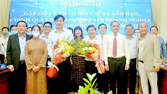 Lãnh đạo TPHCM tại buổi gặp gỡ các doanh nghiệp bất động sản. Ảnh: CAO THĂNG