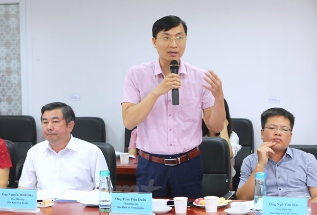Nhà báo Trần Tiến Duẩn phát biểu tại một Diễn đàn báo chí. (Ảnh: Vietnam+)
