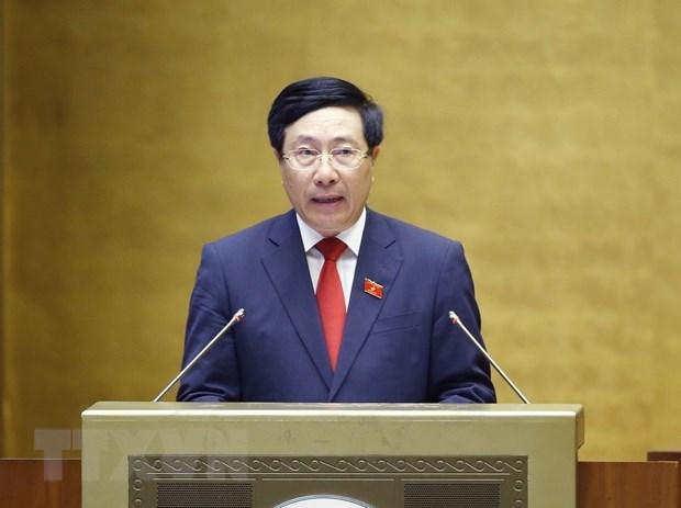 Phó Thủ tướng Chính phủ nhiệm kỳ 2016-2021 Phạm Bình Minh trình bày Báo cáo về đánh giá kết quả thực hiện kế hoạch phát triển kinh tế-xã hội, ngân sách nhà nước 6 tháng đầu năm và các giải pháp thực hiện kế hoạch phát triển kinh tế - xã hội, ngân sách nhà nước 6 tháng cuối năm 2021. (Ảnh: Doãn Tấn/TTXVN)