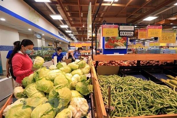 Người dân mua sắm tại một siêu thị Thành phố Hồ Chí Minh. (Ảnh: Tuấn Anh/TTXVN)