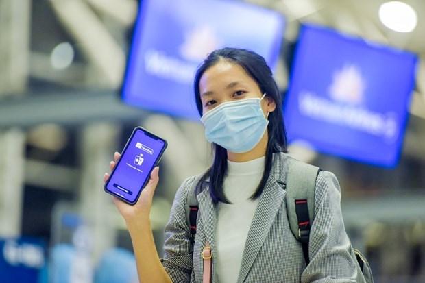 Hành khách tham gia thử nghiệm thành công ứng dụng hộ chiếu sức khỏe điện tử IATA Travel Pass. (Ảnh: CTV/Vietnam+)