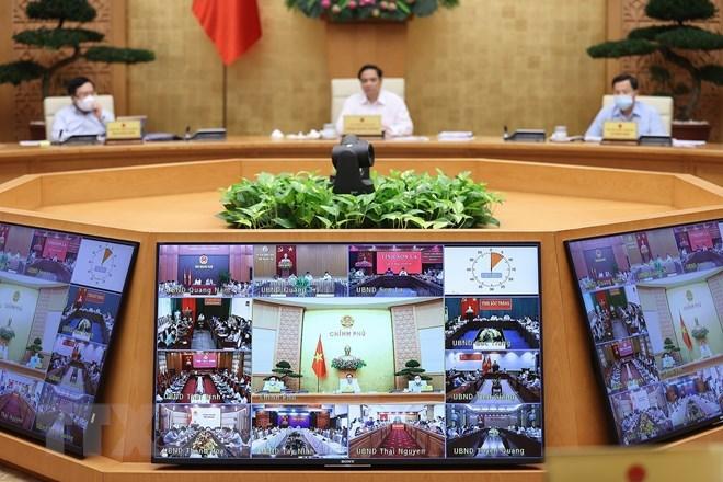 Các địa phương tham dự Phiên họp Chính phủ thường kỳ tháng 9 theo hình thức trực tuyến. (Ảnh: Dương Giang/TTXVN)