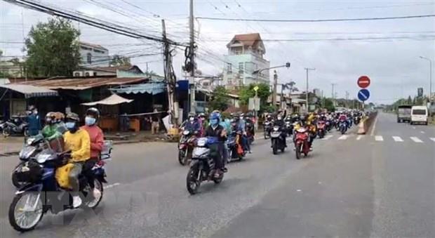 Người dân đi xe máy về quê. (Ảnh minh họa. Nguồn: TTXVN)