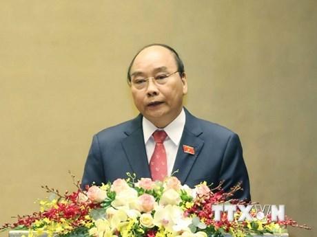 Thủ tướng Nguyễn Xuân Phúc trình bày báo cáo tổng kết của Chính phủ nhiệm kỳ 2016-2021, sáng 24/3. (Ảnh: Thống Nhất/TTXVN)