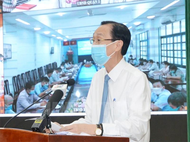 Phó Chủ tịch Thường trực UBND TP Lê Thanh Liêm báo cáo tại hội nghị. Ảnh: Website Thành ủy