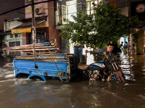 Dự báo mưa lớn sẽ gây ngập úng các vùng trũng thấp tại TP.HCM - Ảnh: Châu Tuấn