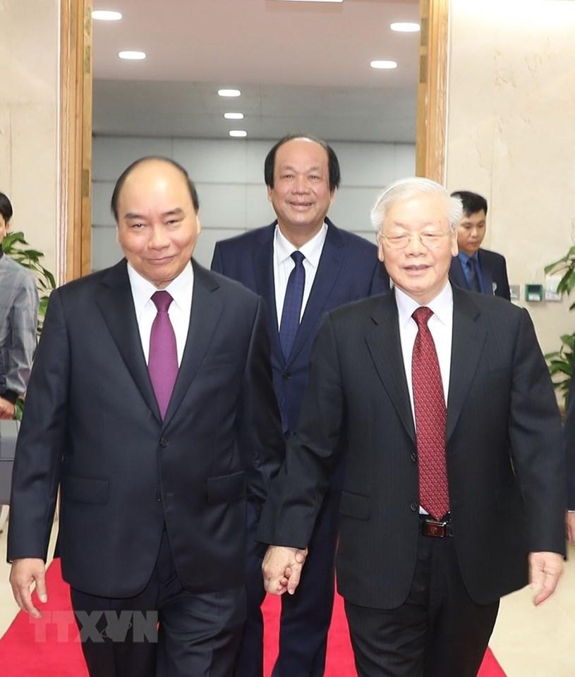 Thủ tướng Chính phủ Nguyễn Xuân Phúc đónTổng Bí thư, Chủ tịch nước Nguyễn Phú Trọng đến dự hội nghị/ Ảnh Trí Dũng - TTXVN