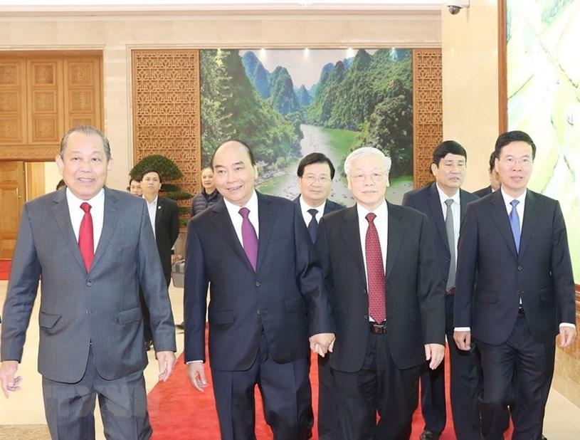 Tổng Bí thư, Chủ tịch nước Nguyễn Phú Trọng,Thủ tướng Chính phủ Nguyễn Xuân Phúc và các đại biểu đến dự hội nghị/Ảnh: Trí Dũng - TTXVN